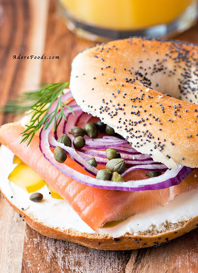 It takes just 10 minutes to make the perfect, healthy Smoked Salmon Bagel. All you need is a bag of bagels, cream cheese, smoked salmon, red onion and capers | Adore Foods
