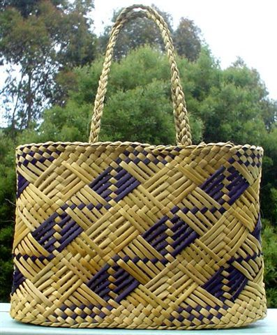 A good kete (Maori flax woven bag) will go with any resort outfit. Don't buy a Chinese fake, get a real one from New Zealand.