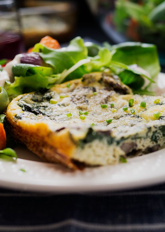 Try this no-stress, low carb brunch menu the next time you need to feed a crowd. An oven baked frittata packed with fresh herbs and vegetables and a green salad dotted with roasted sweet potato and pearl onions. Vegetarian and gluten free.