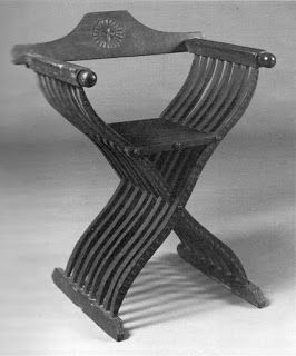 One of Two Savonarola chairs from the Museum fur Angewandte Kunst, Koln, Germany.. Left: walnut, height 86 cm, width 96 cm, depth 59 cm. Seating height 52.5 cm. North Italy, 2nd half 15th century.  Image from museum catalogue MAK Koln.