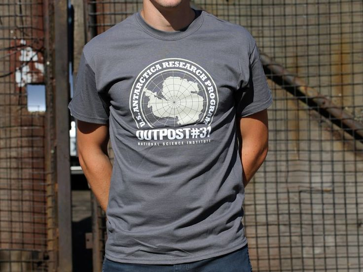 A two colour design, hand screen printed on a regular fit 100% cotton charcoal T-shirt.