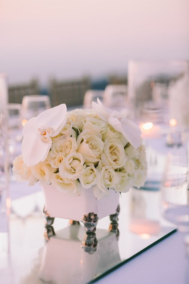 One of our favorite details was the mirror 'aisle' that covered the centre of the entire dinner table adorned with candles and touches of silver & gold creating a wonderful vintage-like sparkle. Santorini Wedding by Stella & Moscha