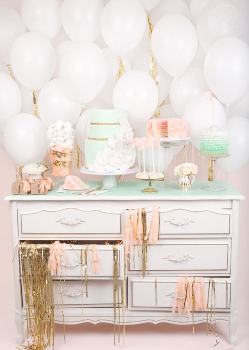 Pretty pastel and confetti system dessert display with balloons