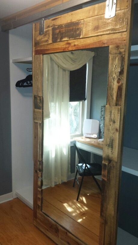 Mirrored closet doors with wood frames most seen images for Mirrored barn door
