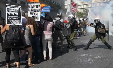 Protesters clash with riot policemen during a a general strike demonstration in Athens, Greece, on 26 September 2012. Greek trade unions called a 24-hour general strike to oppose new austerity measures.