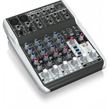 """El ultra-compacto XENYX Q602MP3 con 2-bus de mezcla en 6 inputs ( 2 mic, 2 stereo) permiten comodamente adquirir un sonido de alta calidad premium, gracias a sus 2 on-board studio preamplificadores xenyx disponibles con Phantom Power, y nuestros ultra-musicales EQ """"britanicos"""". Aun más, su reproduct..."""