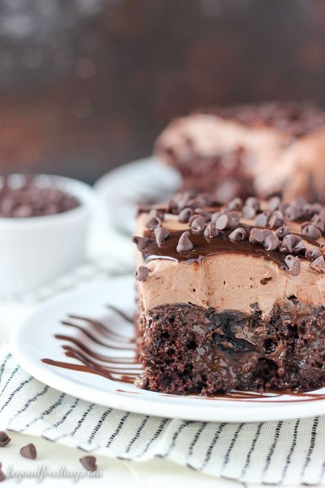 This Sinful Triple Chocolate Poke cake is a chocolate cake, drenched in hot fudge and chocolate pudding. It's topped with a chocolate whipped cream.
