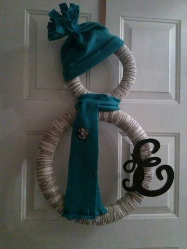Snowman door decor. Two foam wreaths wrapped with yarn. Handmade hat and scarf. Yarn from Meijer. Letter from Hobby Lobby. #meijer. #hobbylobby #snowman: