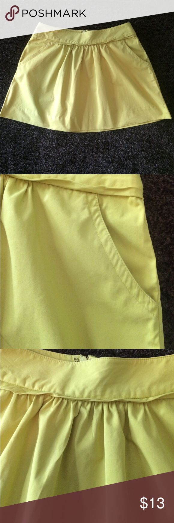 JCrew skirt Gently worn. Zip back and pockets. Color is a yellow/green. Close up pics are true color. Length is 15. Waist 28. J. Crew Skirts