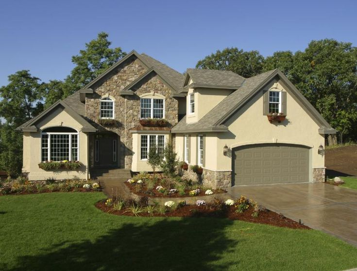 Stone with sandstone stucco exterior paint colors for Stone and stucco home designs