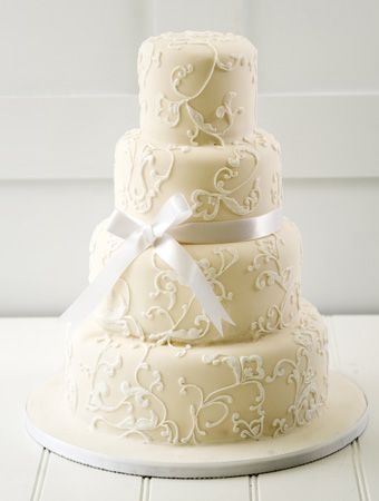 Classic Swirls Wedding Cake... Make the bow any color to match your colors.
