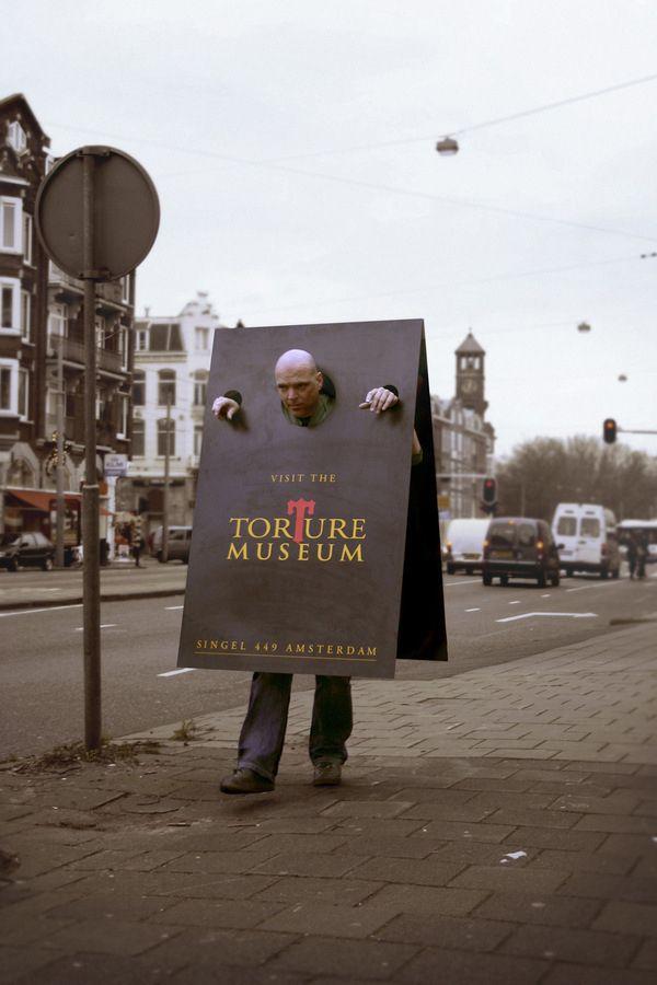 Clever German torture museum street marketing sandwich board.