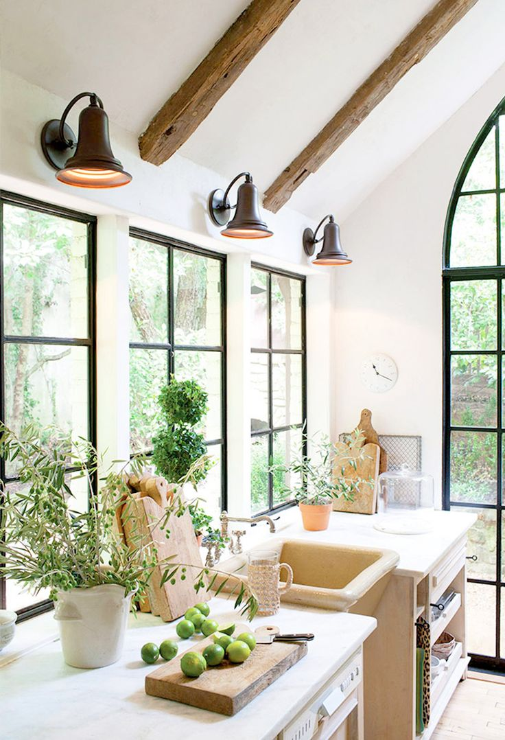 Exposed ceiling beams in the kitchen with industrial lighting