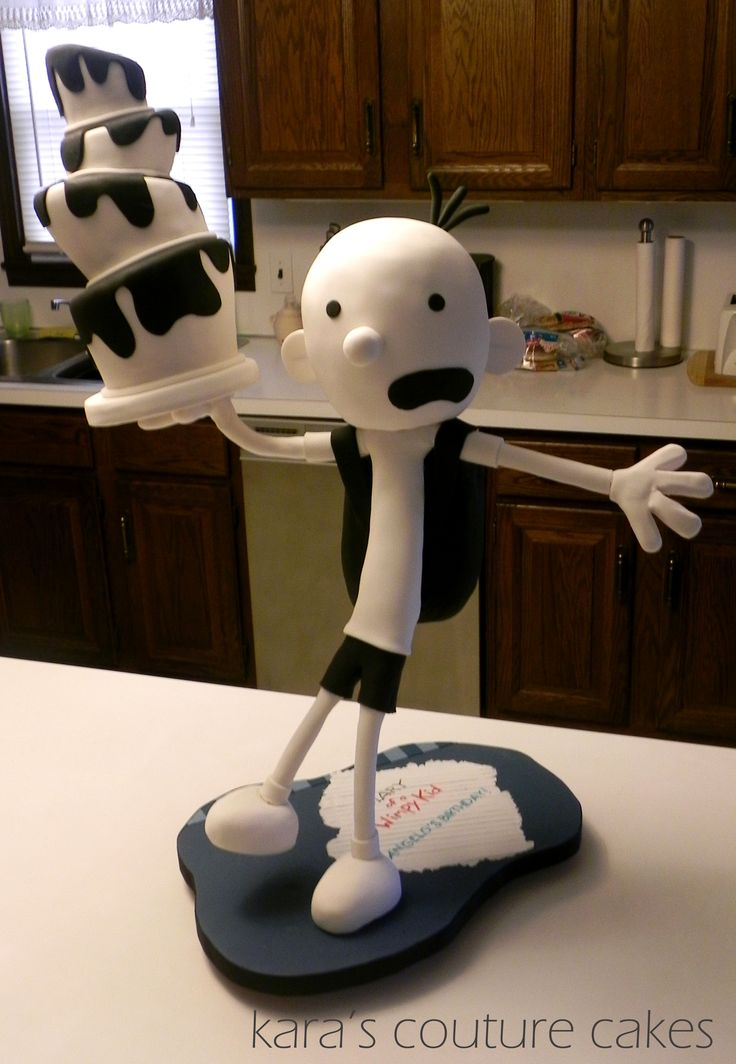 3D Gravity Defying Diary of a Wimpy Kid Cake - Greg Heffley, The Wimpy Kid. He stands 31 inches tall. His topsy-turvey cake is cake, his head is cake, and his backpack is cake. He is covered in modeling chocolate and fondant and is standing on one leg. The cake is vanilla buttermilk with orange creamsicle buttercream.    In the following pics you can see he is leaning back as if he is falling.