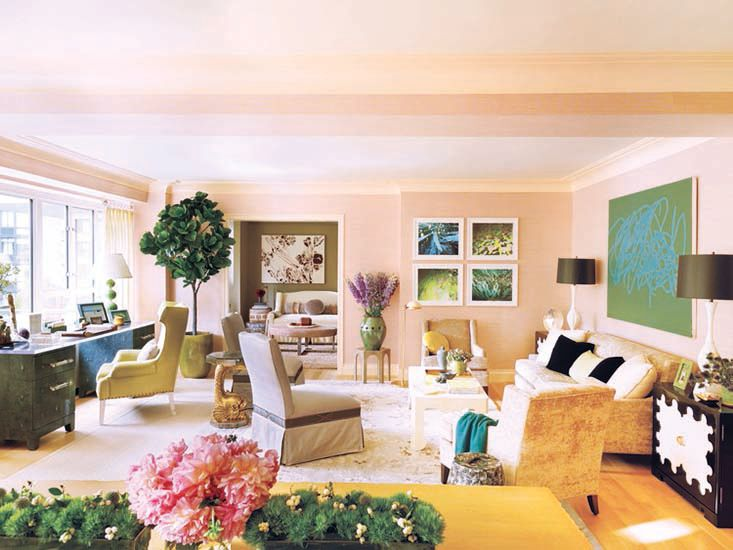 Love the colour play between the soft peachy-pink and the khaki colour of the room beyond.  Elegant upholstered pieces offset by strong furniture elements.