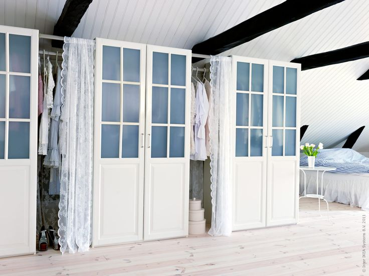 Dressing room with 3 Ikea PAX closets with Birkeland doors and beautiful lace curtains