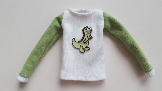 White long sleeved Dinosaur T-shirt with green sleeves for