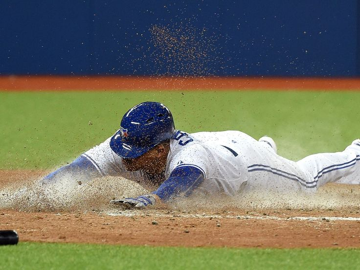 Toronto Blue Jays center fielder Ezequiel Carrera slides in safely to score against Los Angeles Angels in the fourth inning in Toronto. The Angels won 4-3.  Dan Hamilton, USA TODAY Sports