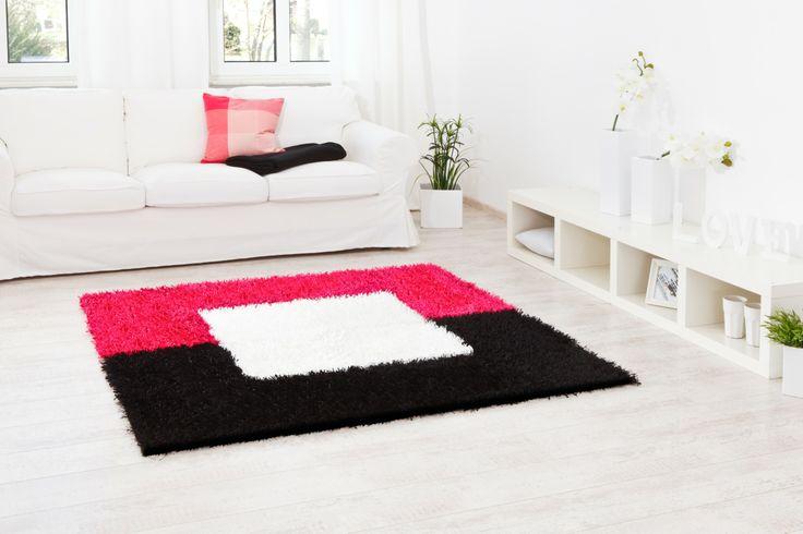 ein Rechteck in pink und schwarz mit einer weißen Mitte - Teppich Al Mano