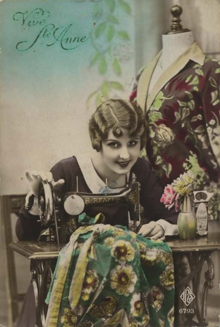 Vintage sewing postcard - lovely lady posing with Pfaff sewing machine.
