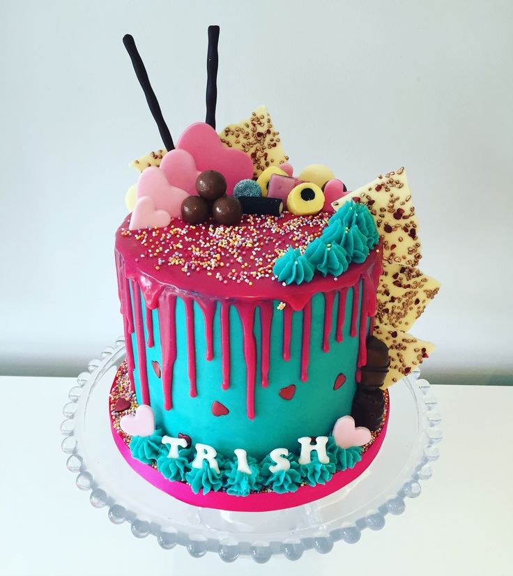 Buttercream drip cake, bright and cheery birthday cake. Chocolate mud cake with Oreo buttercream filling, coated with vanilla buttercream and white (colour s bright pink) chocolate drip and white chocolate hand made shards with raspberry flecks and bronze sprinkles.