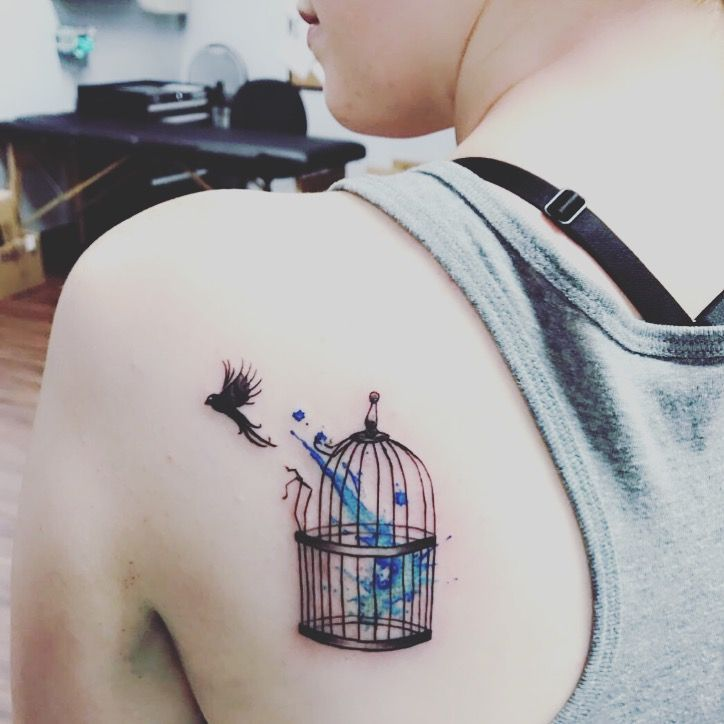 Freeing bird from cage; blue symbolizes emotional abuse