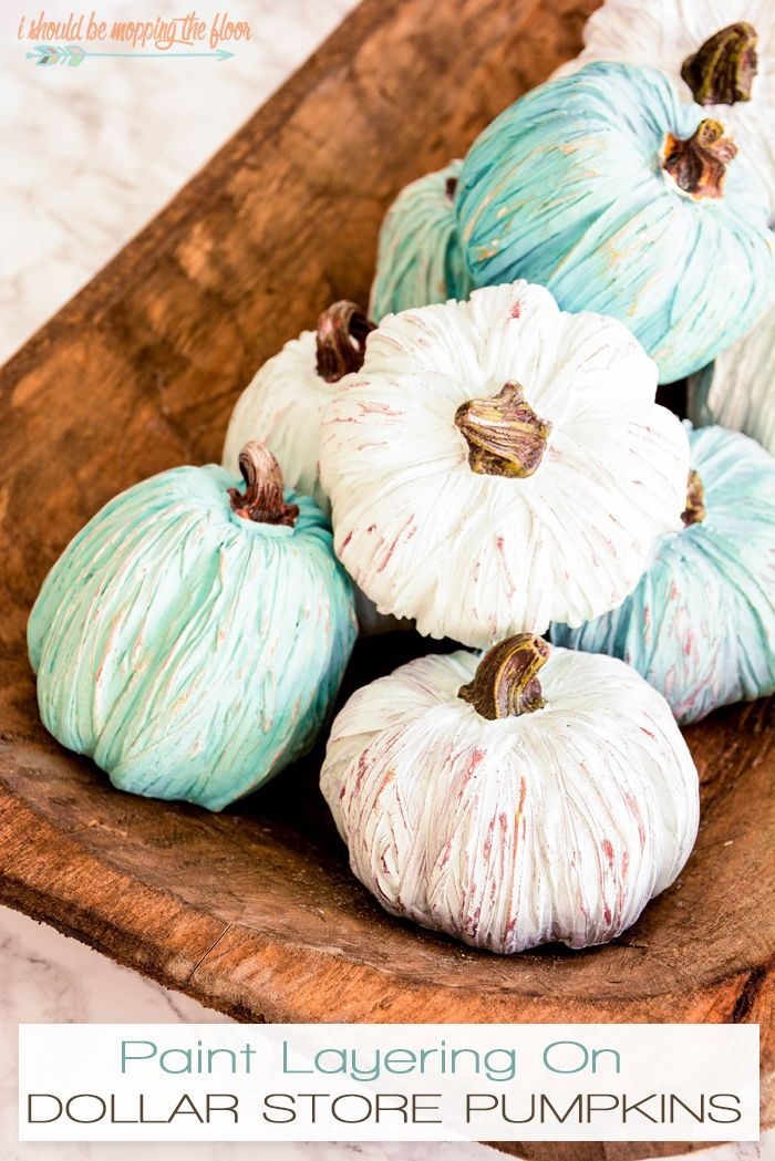 Painted Dollar Store Pumpkins | Give resin pumpkins from the Dollar Tree the weathered fall farmhouse look with a simple 2-paint technique in this tutorial.