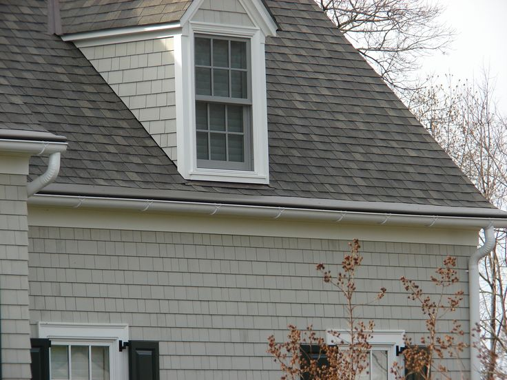 bronze gutter helmet panels installed on this dimensional style roof very clean looking