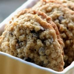 CHEWY CHOCOLATE CHIP OATMEAL COOKIES   -  1 cup butter        1 cup packed light brown sugar        1/2 cup white sugar        2 eggs        2 teaspoons vanilla extract        1 1/4 cups all-purpose flour        1/2 teaspoon baking soda        1 teaspoon salt        3 cups quick-cooking oats        1 cup chopped walnuts        1 cup semisweet chocolate chips