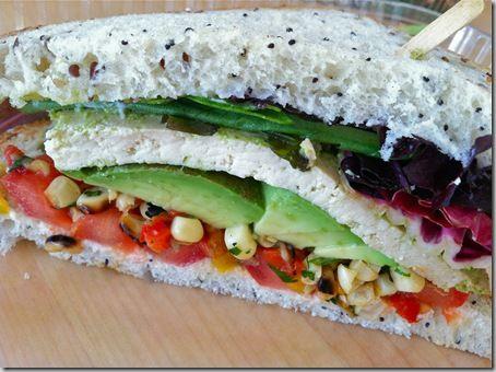 Cilantro tofu sandwich with avocado, tomato, grilled corn relish ...
