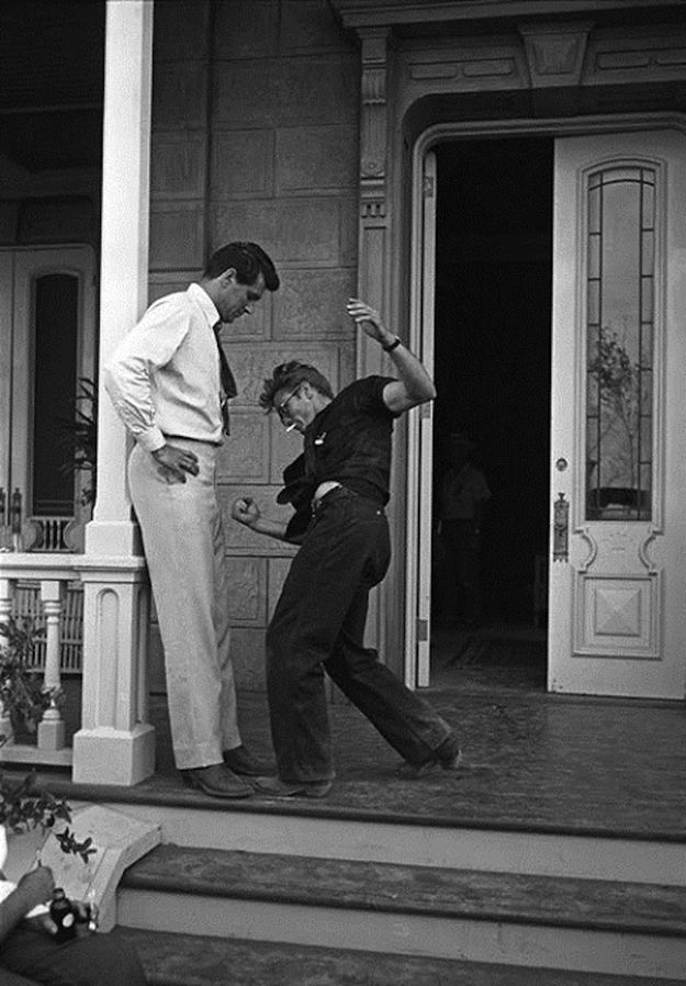 Rock Hudson and James Dean behind the scenes of Giant (1956). Such a great candid moment they caught.