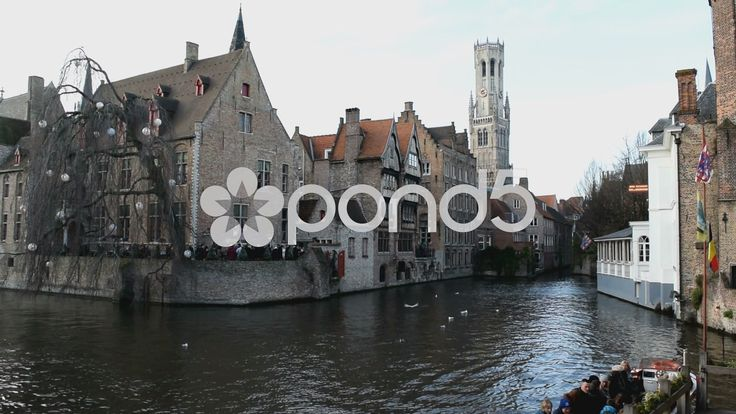 Popular canal area in Bruges, Belgium. Belfry visible. Sound of bells & tourists - Stock Footage | by glenman77