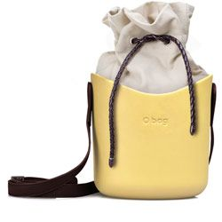 O Basket - Yellow '50 with Brown Faux Leather Strap and Natural Shade Canvas Insert with dark brown faux leather drawstring. The O Basket is a spacious bucket type shoulder bag with its own range of straps and canvas drawstring inserts. The O basket body is moulded from a material called EVA (ethylene vinyl acetate) making it soft, tactile, waterproof, lightweight and resilient. Designed and made in Italy. New for Autumn 2014. Dimensions: Max height 20cm, width 23cm, depth 17cm.