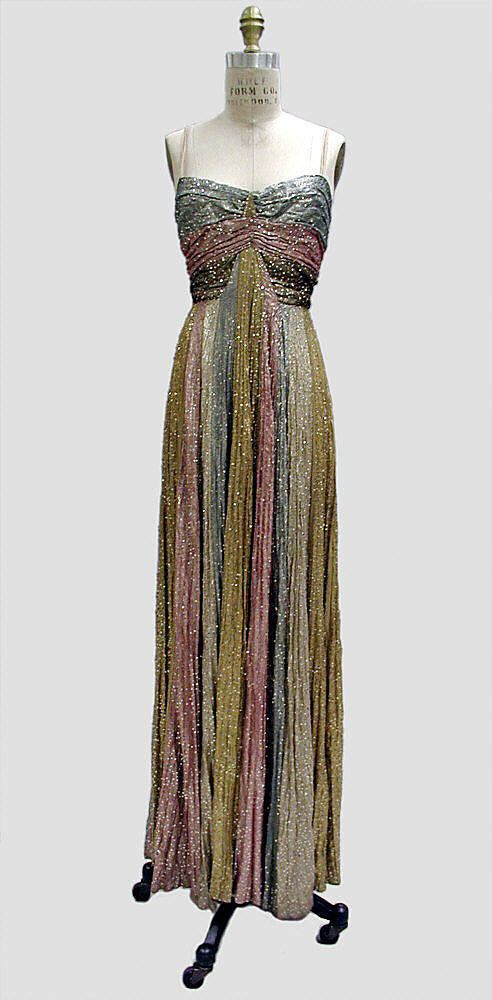 Evening dress Madeleine Vionnet (French, Chilleurs-aux-Bois 1876–1975 Paris) Maker: Hattie Carnegie, Inc. (American) Date: fall/winter 1937–38 Culture: American Medium: metal thread.
