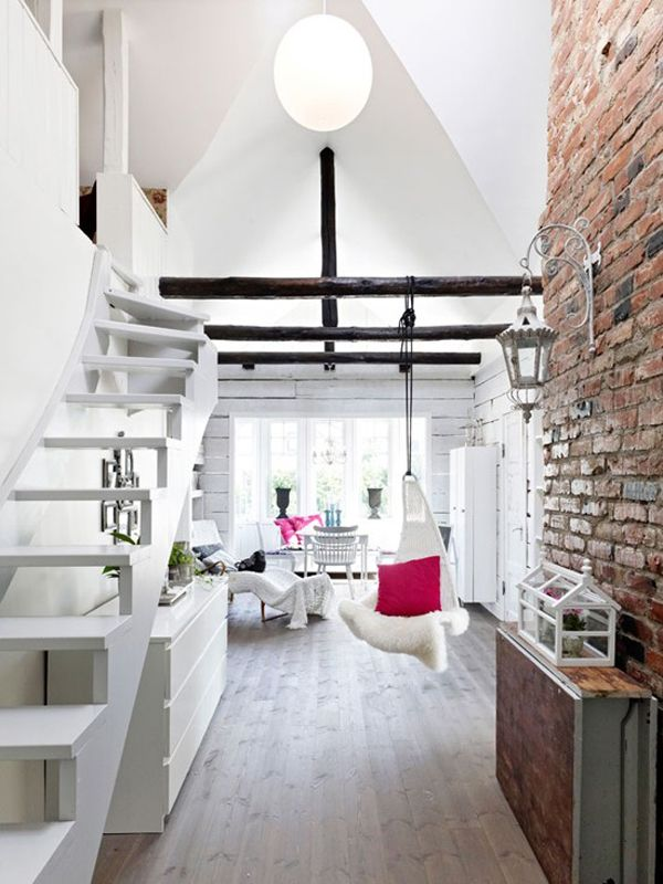 love the brick wall + swing chair