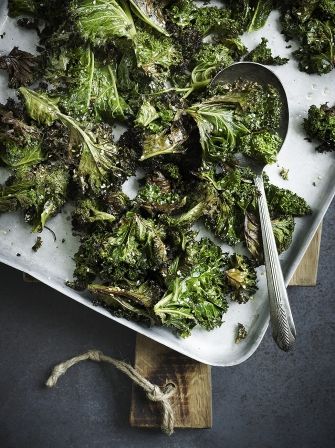 This Asian inspired Sesame Roasted Kale from Jamie Oliver will be a hit with the whole family and is a  healthy vegetarian snack packed with superfoods .
