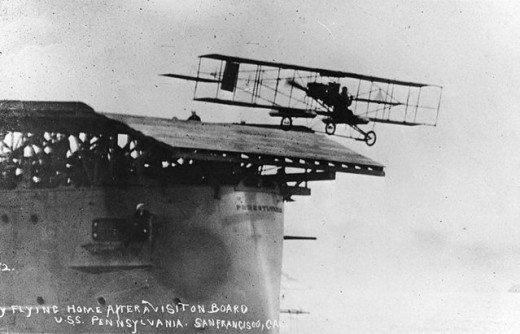 'On November 14, 1910, Eugene Ely became the first pilot to successfully launch a plane from a stationary ship. The Curtiss pusher airplane, one of the first models in the world to be built in any significant quantity, flew for two miles before Ely landed on a beach. Using the same aircraft, Ely landed on the USS Pennsylvania on January 18, 1911