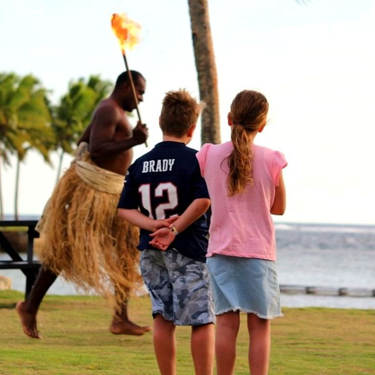 Archie and Rissie watching some Fijian fire theatrics!