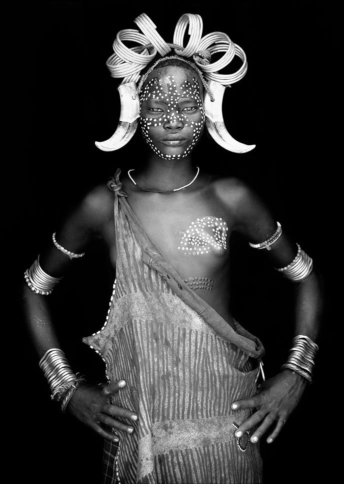 Africa | Young Mursi girl in Omo Valley, Ethiopia | ©John Kenny