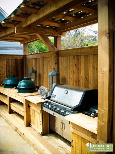 this custom cedar fence and grill pit was built by production fenceworks.
