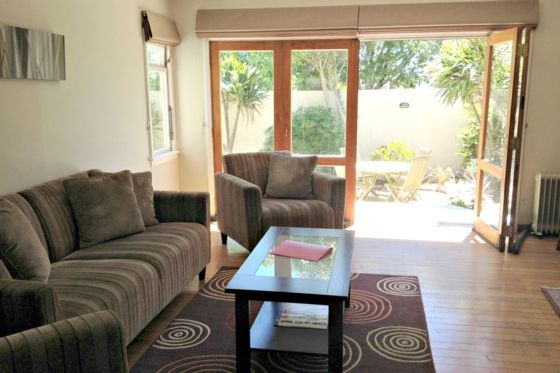Bifold doors open up the living area to the deck