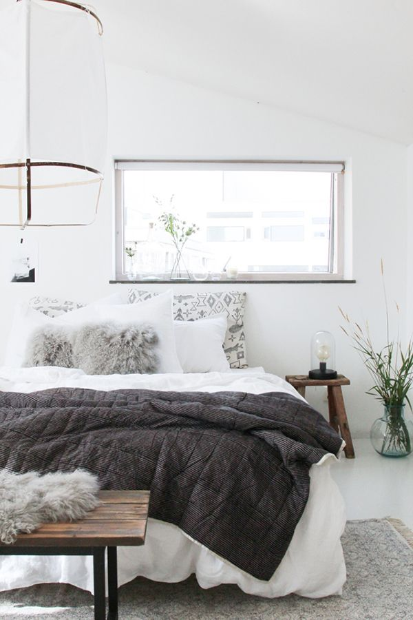 This stunning bedroom reflects the Danish trend of making their homes into hygge havens, with their heavy wood, leather and cosy sheepskin rugs and throws. More