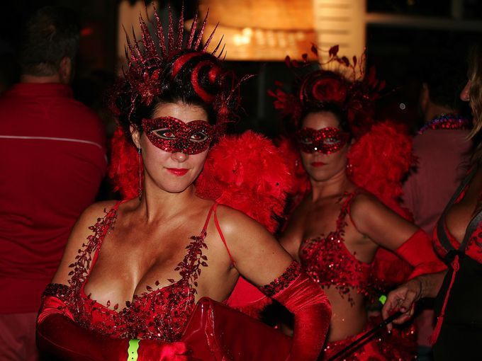 Costumed performers take to the streets of Key West during Fantasy Fest. The event is appealing to photographers, revelers, horror fans and ...