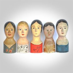 These paper mache heads were used by milliners to shape new hats or display them to customers. c. 1860