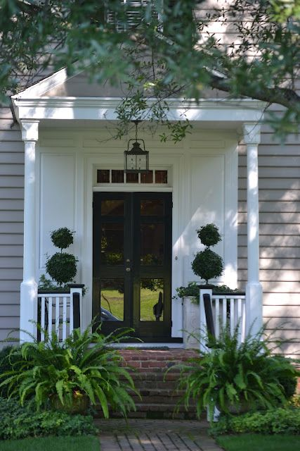 Topiaries In Tall Pots With Boston Ferns In The Foreground Beautiful Front Porch Although I