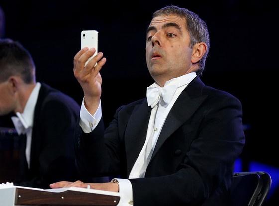 Rowan Atkinson:got bored while playing the keyboard during opening ceremonies. Hahaha!