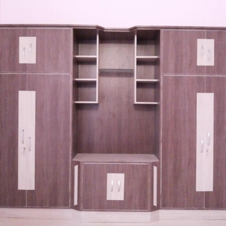 Amazing wardrobes designs for bedrooms Design Wardrobe Designs For Bedroom Using Laminates And Place For TV cool modern wardrobes designs for bedrooms