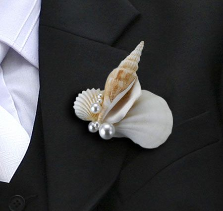 This seashell boutonniere is the perfect beach accent for the groom and groomsmen - different!