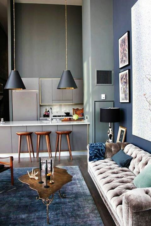 Nice colours, copper and blue! Tufted couch pendant lights and industrial bar stools