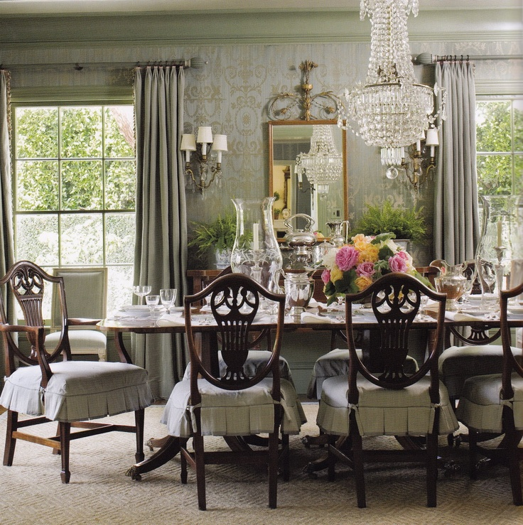 Dining Room chairs can be easily changed with these charming shortfalls note use of glass on table and chandelier.